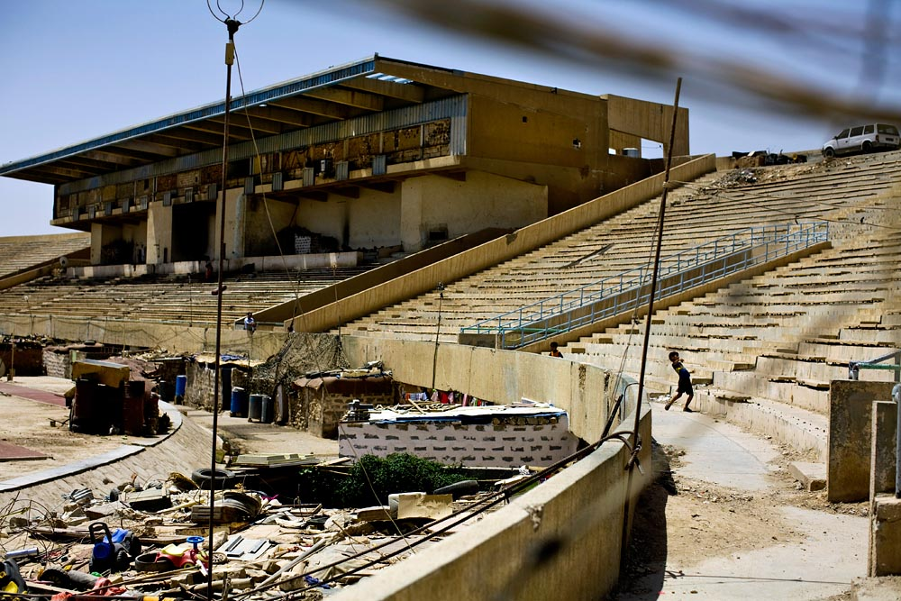 Kurdish refugees are forced to live in squalor inside the Kirkuk soccer stadium in Kirkuk, Kurdistan, Iraq.
