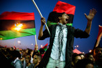 Libyan rebels and Bengazi residents celebrate the passing of a UN resolution calling for a no-fly-zone over Libyan airspace, and their belief of dictator Muammar Gaddafi's imminent demise.