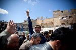 "A Libyan man screams ""God is Great,"" during a funeral procession in Bengazi."
