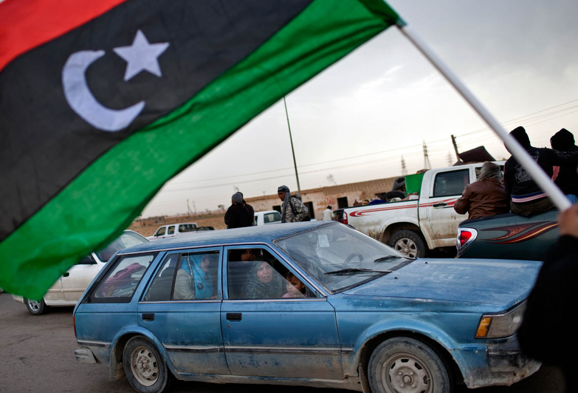 Libyan civilians flee an anticipated Gaddafi Loyalist attack on Ajdabiya.