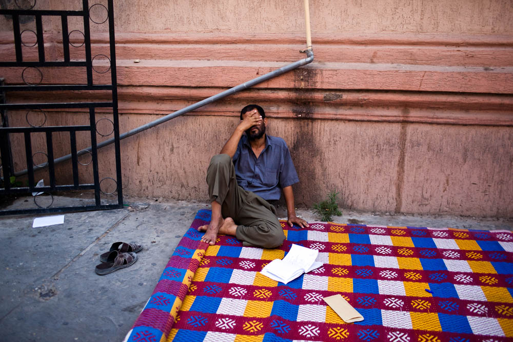 A man weeps as a crowd gathers to read a list of Libyan civilians who have disapeared following the arrival of opposition forces in Tripoli.