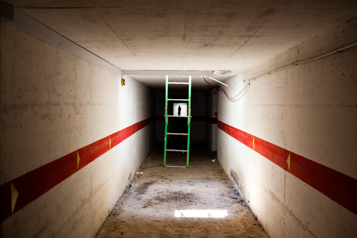 A Libyan walks through Gaddafi's secret underground tunnles that line the infamous Bab al-Aziziyia compound.