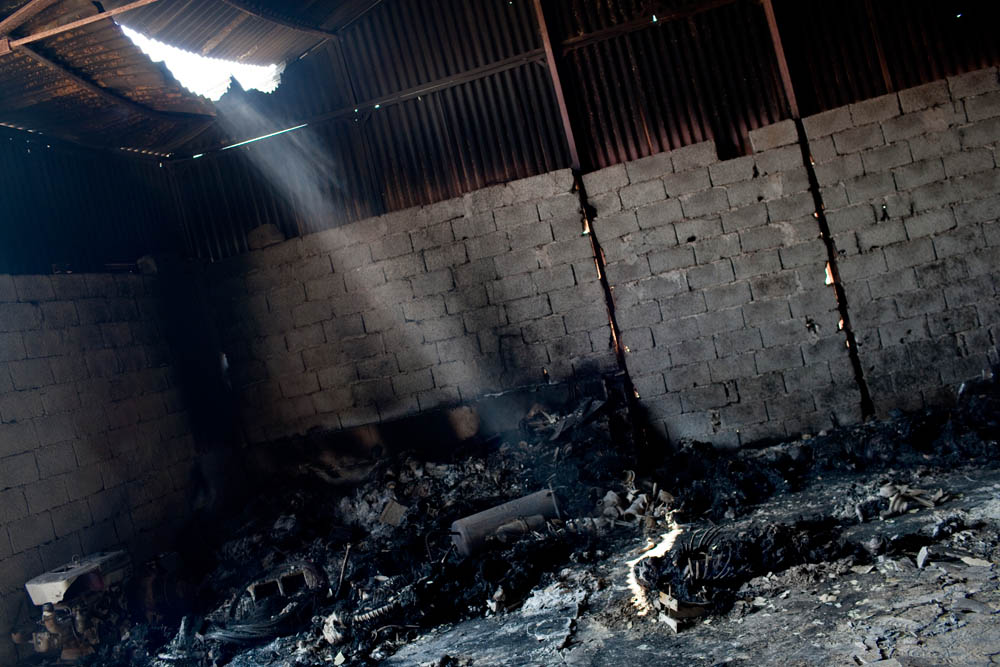 At least 50 burnt bodies were discovered in a construction site shed near the base for the infamous Khamis Brigade.
