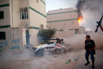 Libyan rebels destroy their own vehicle as they fire a 40mm recoiless rifle at Gaddafi loyalist troop positions.