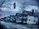 Shoes hang from a utility cable on a street lines with vacant and abandoned homes on January 30, 2012 in Cleveland, OH.