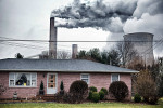 The stacks from the Gavin coal burning power plant dwarf a small nearby home on February 4, 2012 in Cheshire, OH.