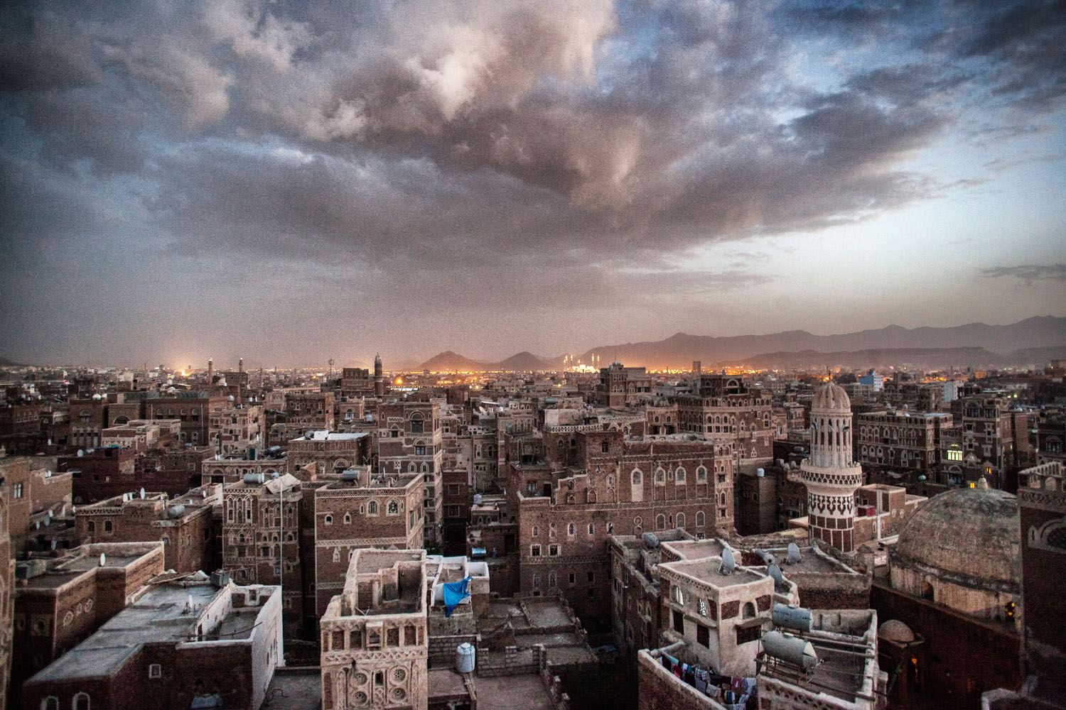 The sun sets over the Old City of Sana'a.