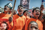 Yemeni Activists stage an anti-Guantanamo protest in front of the American embassy in Sana'a, Yemen.