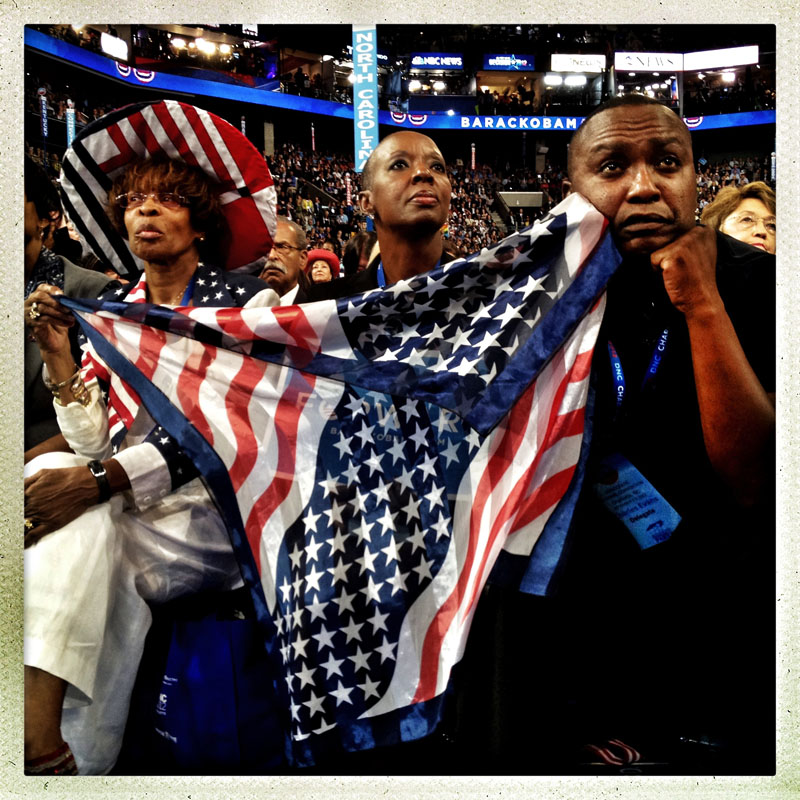 Delegates from North Carolina watch President Obama's keynote speech from the floor of the Democratic National Convention.