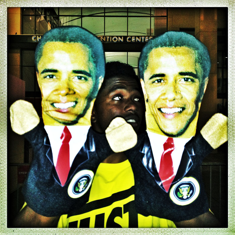 A street vendor sells Barak Obama hand puppets outside the Time Warner Arena following the conclusion of the first session of the Democratic National Convention.