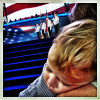 A young child sleeps on his mother's shoulder as the color guard marches on stage during the opening ceremonies of the 2012 Democratic National Convention.