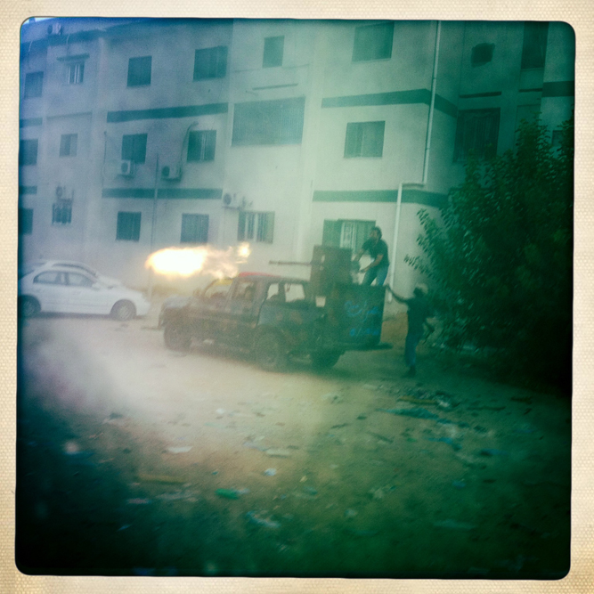 Libyan rebels fire a 220 machine gun toward a Gaddafi loyalist position.