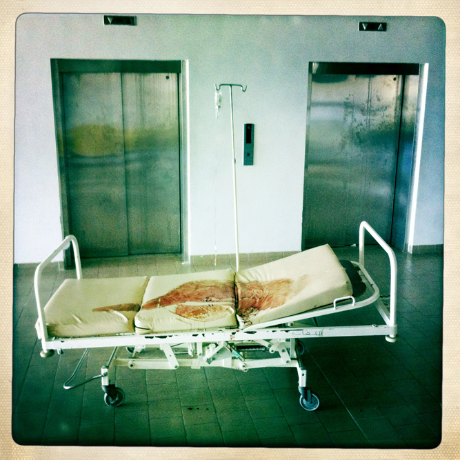 The marks of an execution, a bloddied gurney and splattered blood, are all that remain in the hallway of the Abu Salim Hospital .