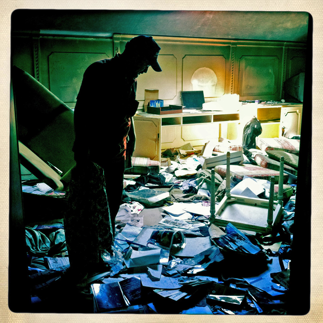 A Libyan rebel sorts through the looted belongings of former Libyan dictator Moammar Gaddafi in his Bab al-Aziziya compound.