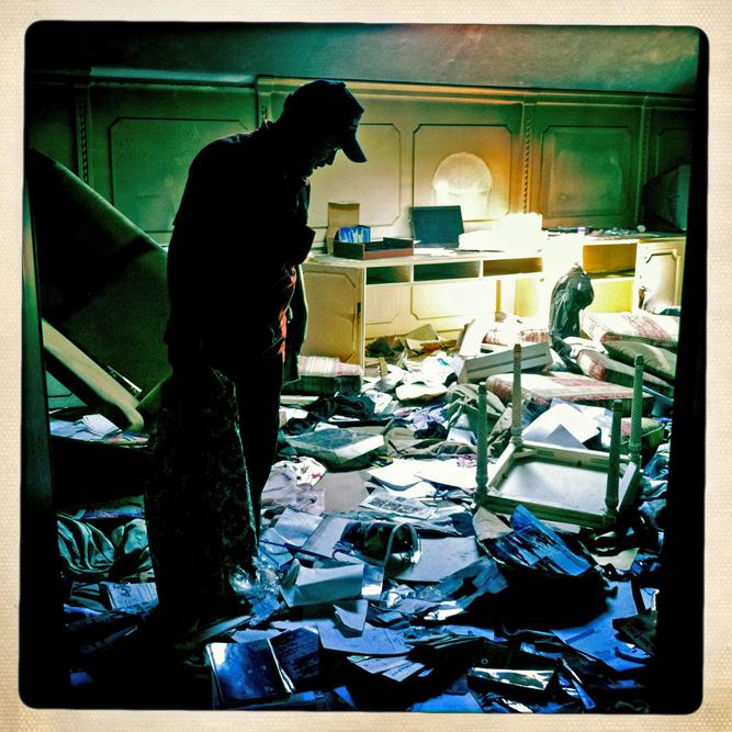 A Libyan rebel sorts through the looted belongings of former Libyan dictator Moammar Gaddafi in his Bab al-Aziziya compound.