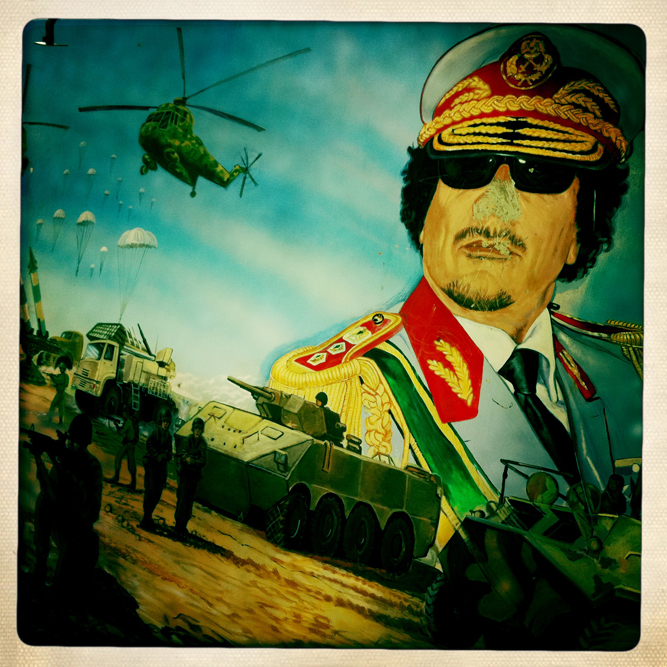 A mural depicting a victorious battle of the Libyan military forces against a vague enemy is painted on the Khamis Brigade parade ground.