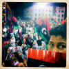 Libyans celebrate the fall of Libyan dictator Moammar Gaddafi in the the newly renamed Martyr's Square.