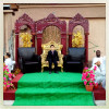 MISRATA, LIBYA - JULY 5: The sibling of the groom sits on a traditional wedding {quote}throne{quote} where male attendees of a wedding party await to greet and celebrate the grooms marriage along the ruins of Misrata's infamous Tripoli Street on July 5, 2012 in Misrata, Libya.