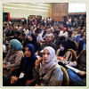TRIPOLI, LIBYA - JULY 17: A packed crowd of Libyan lawmakers, politicians, and journalists watch a memorial video honoring the fallen martyrs of the Libyan revolutionary war prior to the official results presentation of Libya's first elections in 4 decades on July 17, 2012 in Tripoli, Libya.