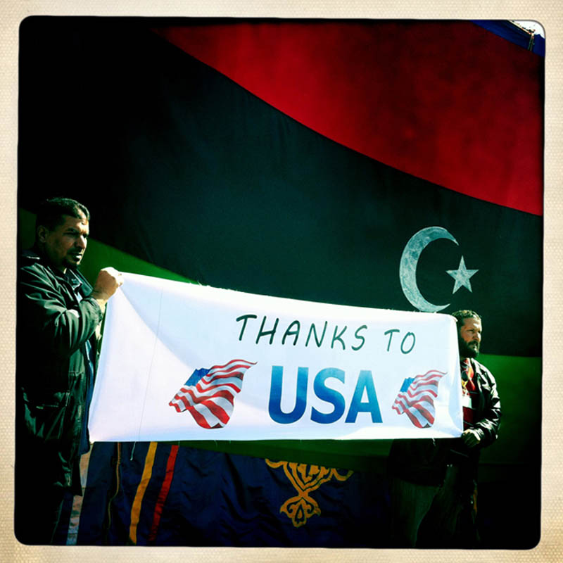 Libyans thank America during Friday prayers.