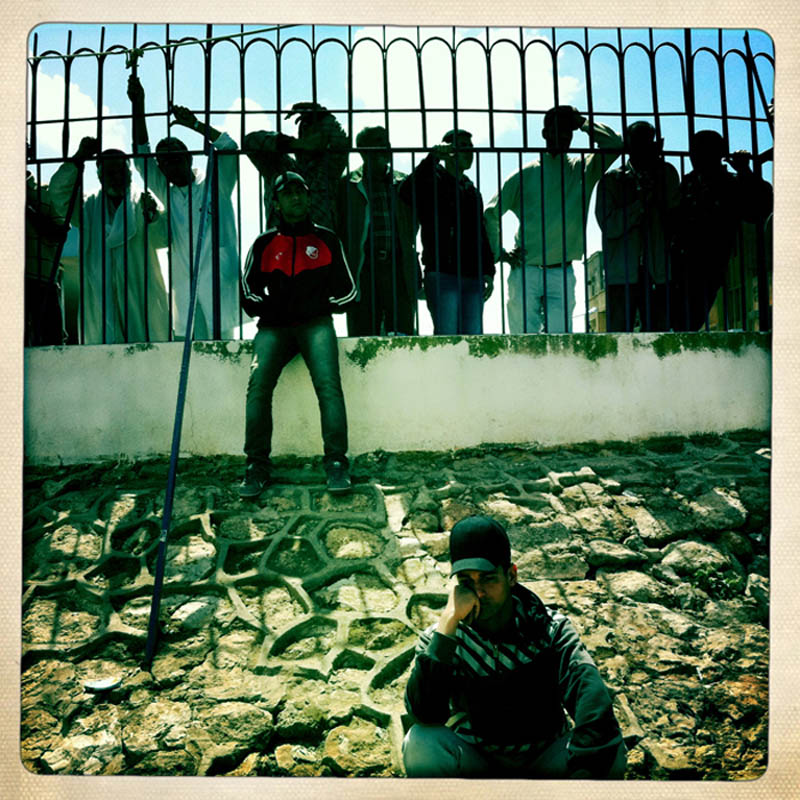 Onlookers watch as relatives drive away with the body of their kin after visiting the Jala Hospital morgue.