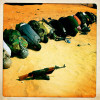 Libyan rebels pray in the desert sand near the front line near Bin Jawad.
