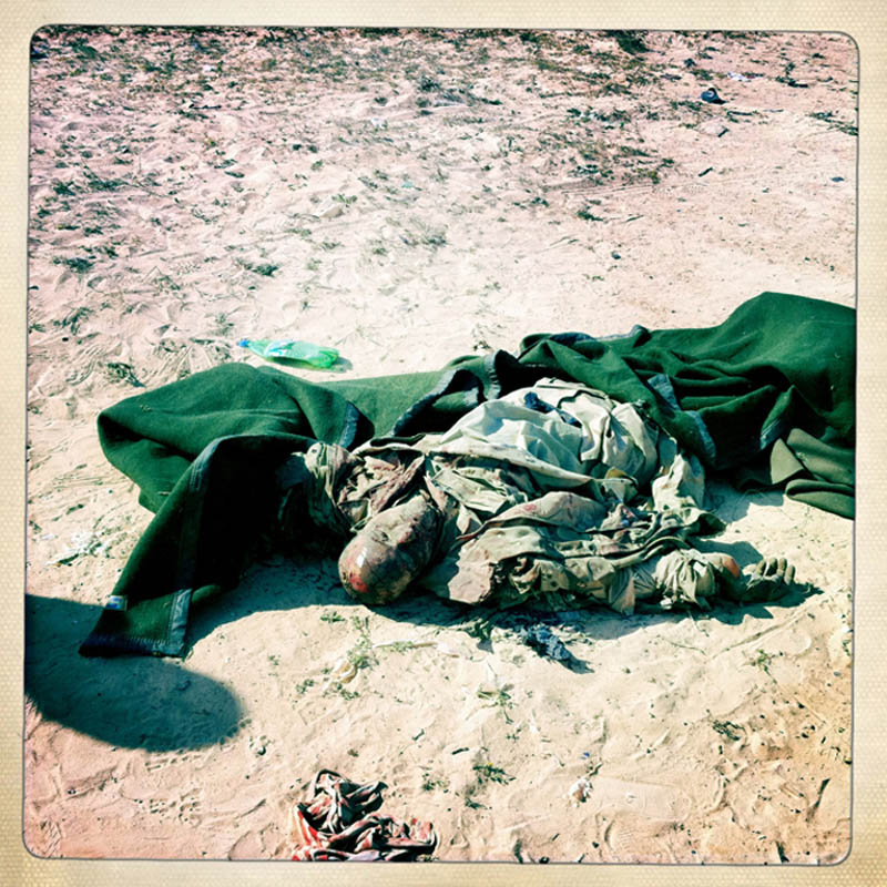 The body of a dead Gaddafi loyalist soldier.
