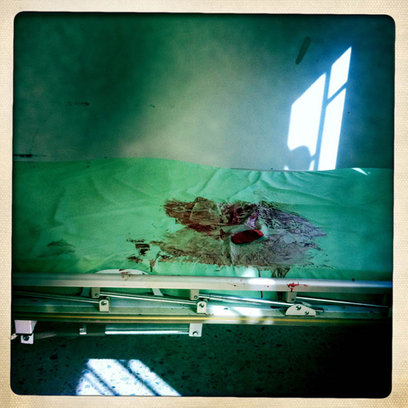 Fresh blood coats an empty hospital bed in Ajdabiya.