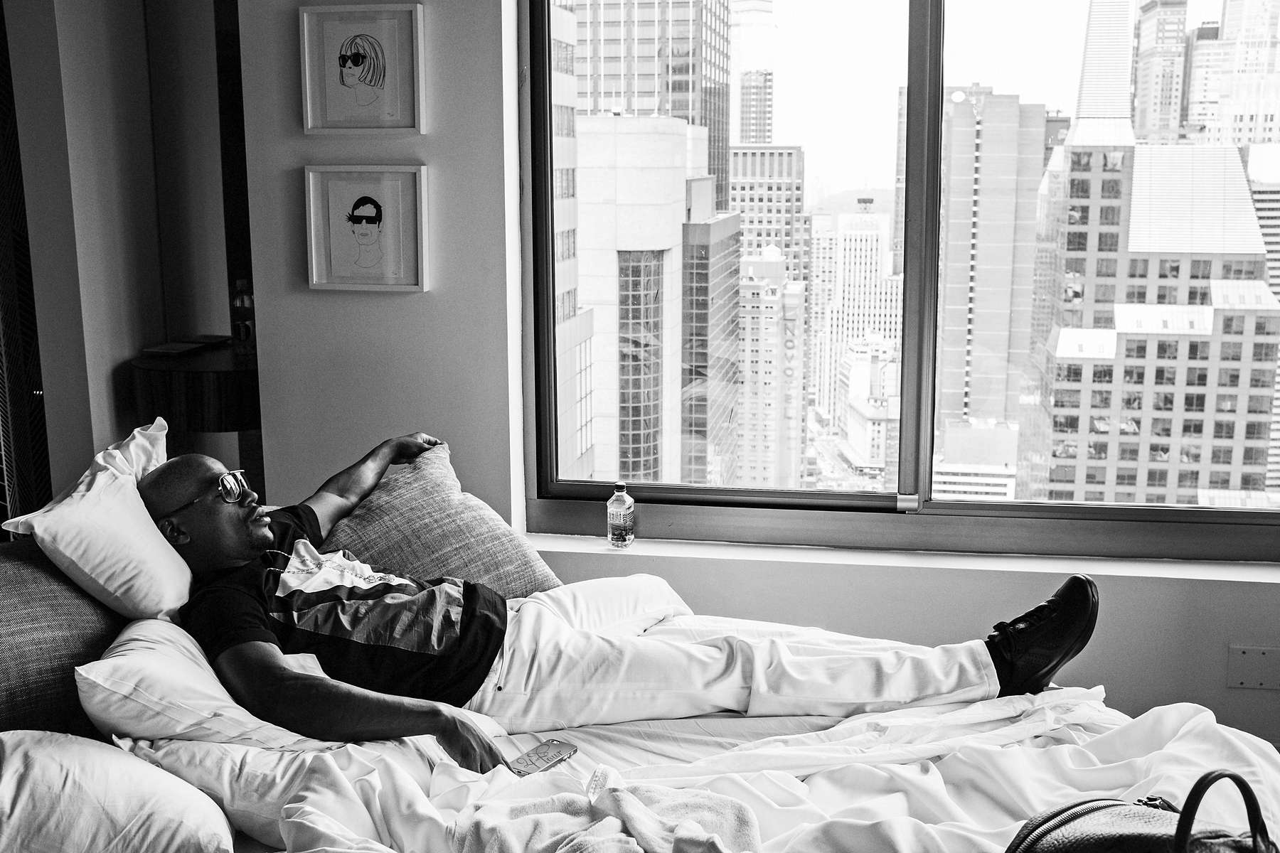 NEW YORK CITY, NY - JUNE 24: Floyd Mayweather Jr. lounges in his suite at the W Hotel in Times Square before the start of an 11-city promotional tour for his Sept. 14 bout with Saul {quote}Canelo{quote} Alvarez. (Photo by Benjamin Lowy/Reportage by Getty Images)
