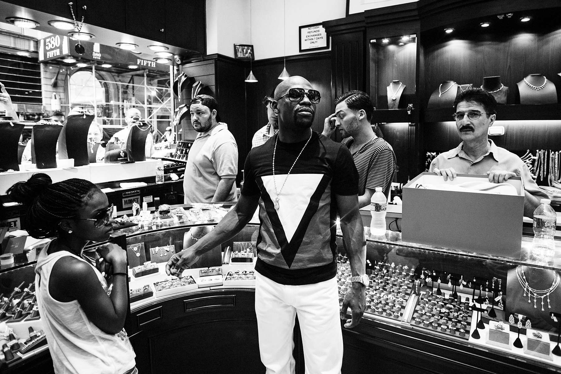 NEW YORK CITY, NY - JUNE 24: Boxer Floyd Mayweather looks at the merchandise on display at Rafaello & Co., a New York City jewelry store that caters to the ultrarich. Mayweather spent over $250K in one hour. (Photo by Benjamin Lowy/Reportage by Getty Images)