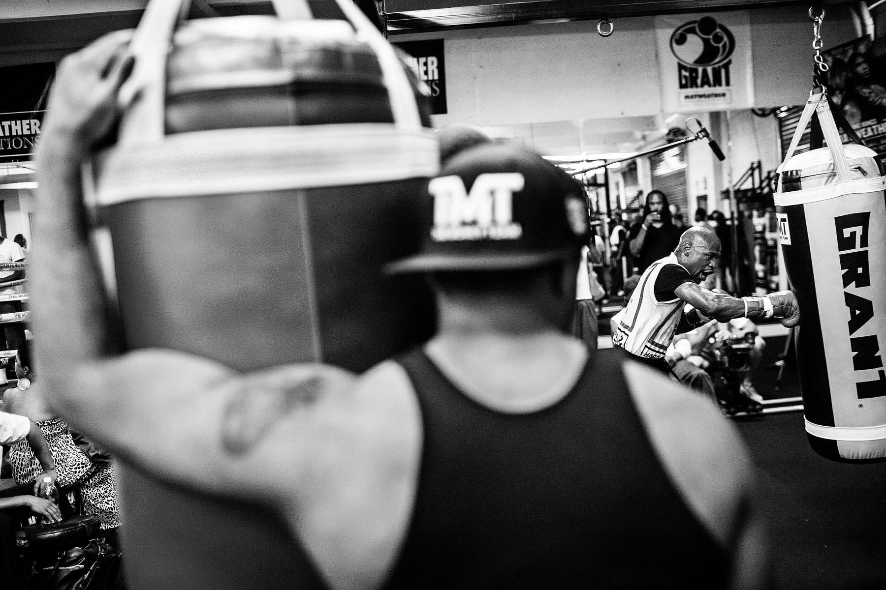 LAS VEGAS, NV - AUGUST 10: With temperatures in the gym exceeding 100 degrees, boxer Floyd Mayweather hits the heavy bag during practice. He throws about 8,000 punches per workout. (Photo by Benjamin Lowy/Reportage by Getty Images)