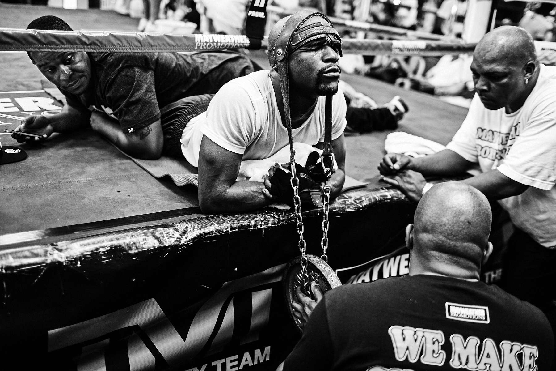 LAS VEGAS, NV - JULY 26: Mayweather goes through a medieval neck workout as Mayweather Promotions CEO Leonard Ellerbe guides the weight, his uncle John Sinclair (right) watches and an assistant holds his legs. (Photo by Benjamin Lowy/Reportage by Getty Images)