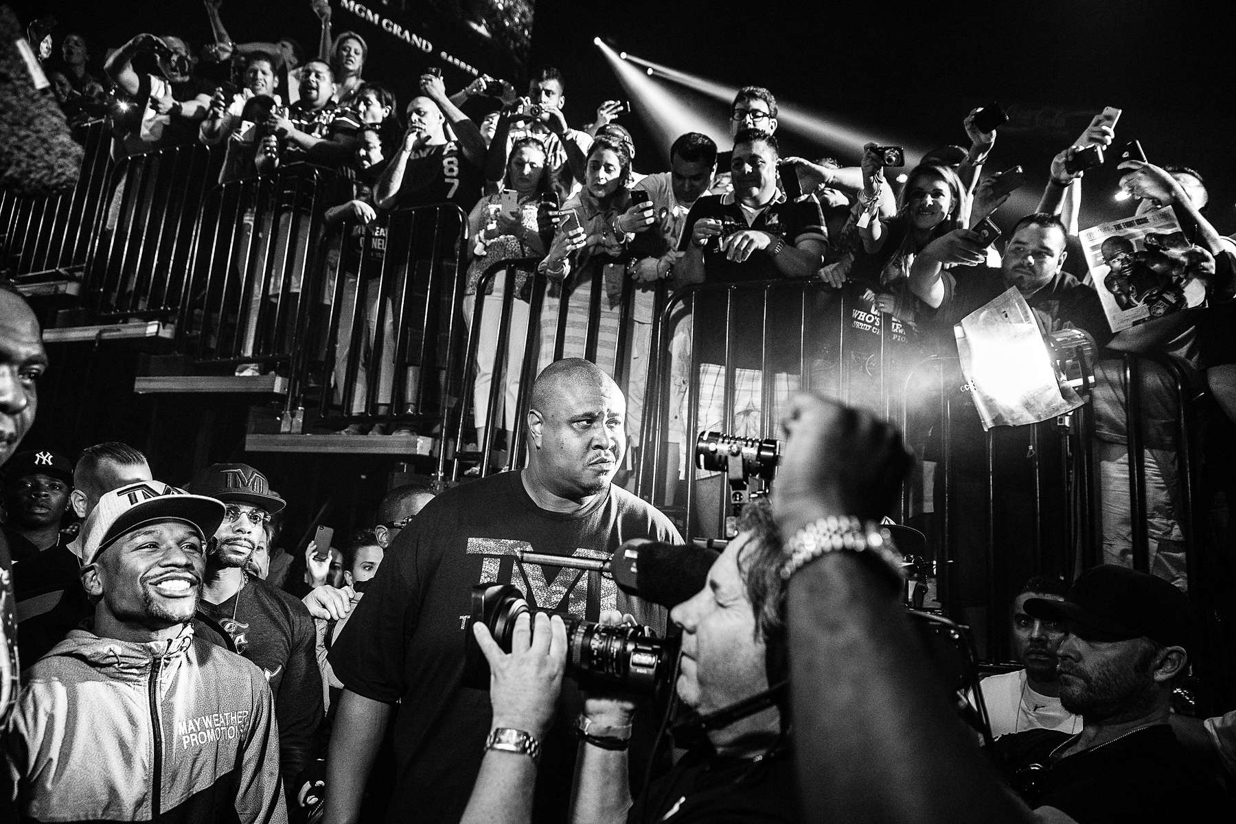 LAS VEGAS, NV - SEPTEMBER 13: Mayweather smiles as he's greeted by a raucous crowd before the weigh-in at the MGM Grand Garden Arena. (Photo by Benjamin Lowy/Reportage by Getty Images)