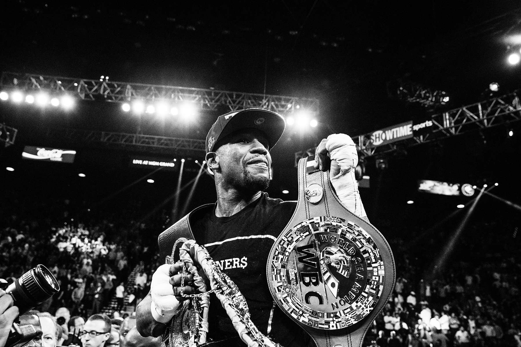 LAS VEGAS, NV - SEPTEMBER 14: Mayweather, his record now 45 wins, and no loses, holds his championship belts aloft following his win over Alvares. (Photo by Benjamin Lowy/Reportage by Getty Images)