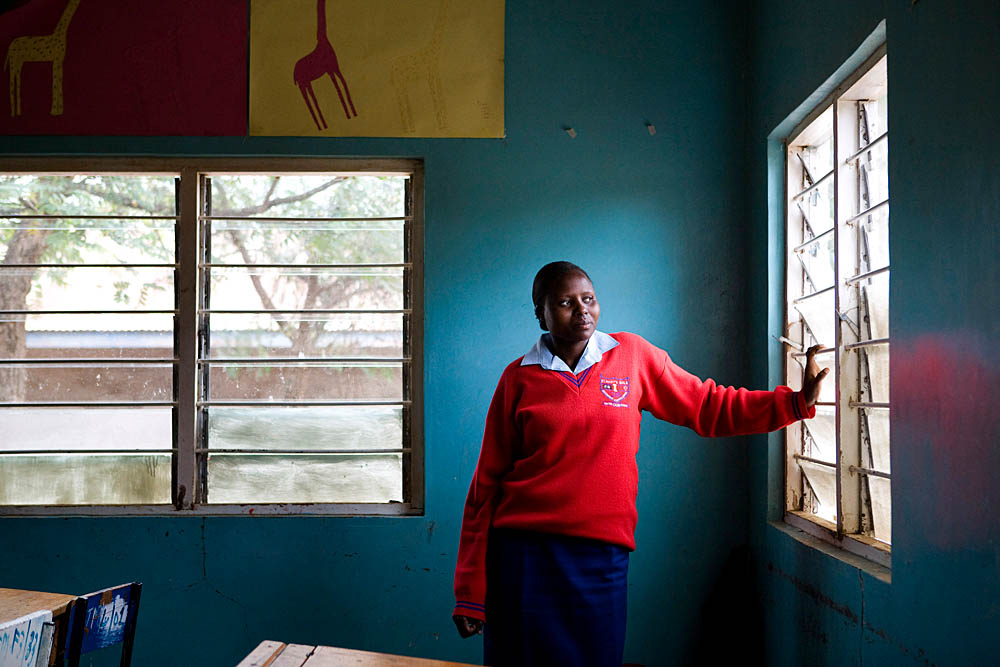 Pirias Jeniffer Kiok, 17, poses for a portrait inside her classroom at St. Mary's Secondary School. Jeniffer escaped from early marriage because she wanted to continue with her education. She knew that if she were to wed, she would have had to quit school and fulfull her {quote}wifely duties.{quote}