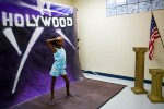 "Kennedy Wynn, 10, gets her picture taken during the Holywood Retreat at the Destiny World Church June 15 in Austell, GA. Young children, teenagers and their parents or guardians came together for three days to promote abstinence. Issues like STDs, peer pressure, teen pregnancy,  molestation and abuse were also main topics of panel discussions. The Holywood Retreat concluded with a Purity Ring Ceremony where each participant pledged to keep their virginity or to no longer participate in sex outside of marriage by wearing a ""purity ring"" on their wedding finger until the day it is replaced by a wedding ring. The three day event featured ministers and lay speakers, a fashion show that illustrated how one can remain modest and fashionable, a religious concert as well as other activities that entertained a predominantly young and energetic group."