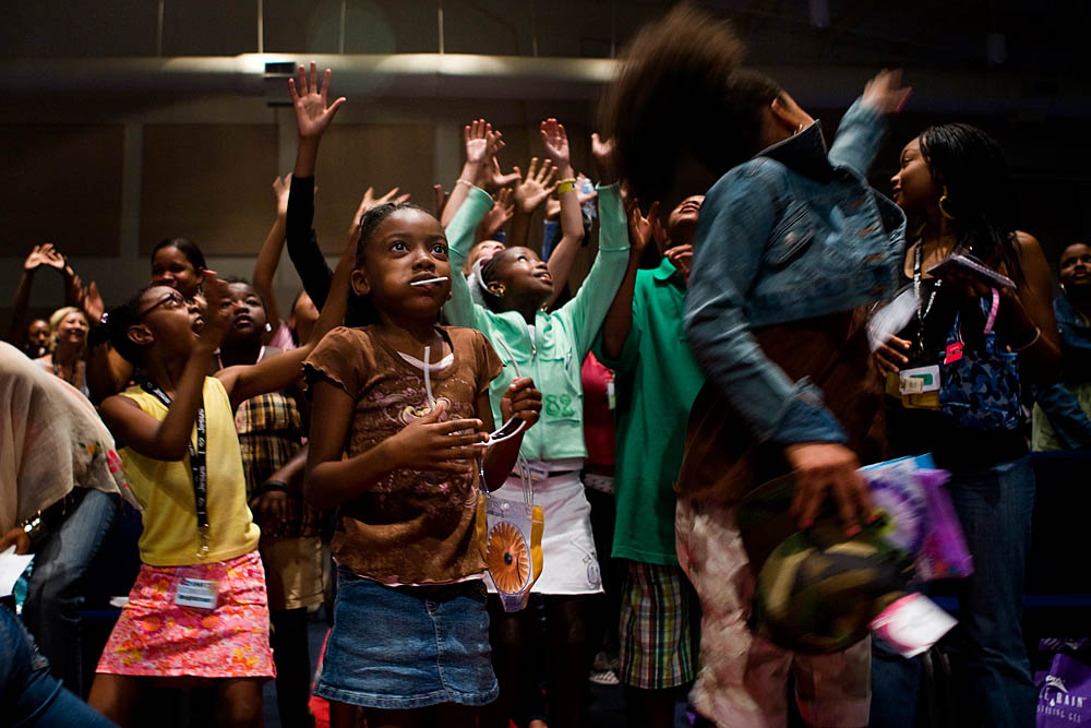 Young girls  jump for gifts and goodie bags at the Destiny World Church June 15 in Austell, GA. Young children, teenagers and their parents or guardians came together for three days to promote abstinence. Issues like STDs, peer pressure, teen pregnancy,  molestation and abuse were also main topics of panel discussions. The Holywood Retreat concluded with a Purity Ring Ceremony where each participant pledged to keep their virginity or to no longer participate in sex outside of marriage by wearing a {quote}purity ring{quote} on their wedding finger until the day it is replaced by a wedding ring. The three day event featured ministers and lay speakers, a fashion show that illustrated how one can remain modest and fashionable, a religious concert as well as other activities that entertained a predominantly young and energetic group.