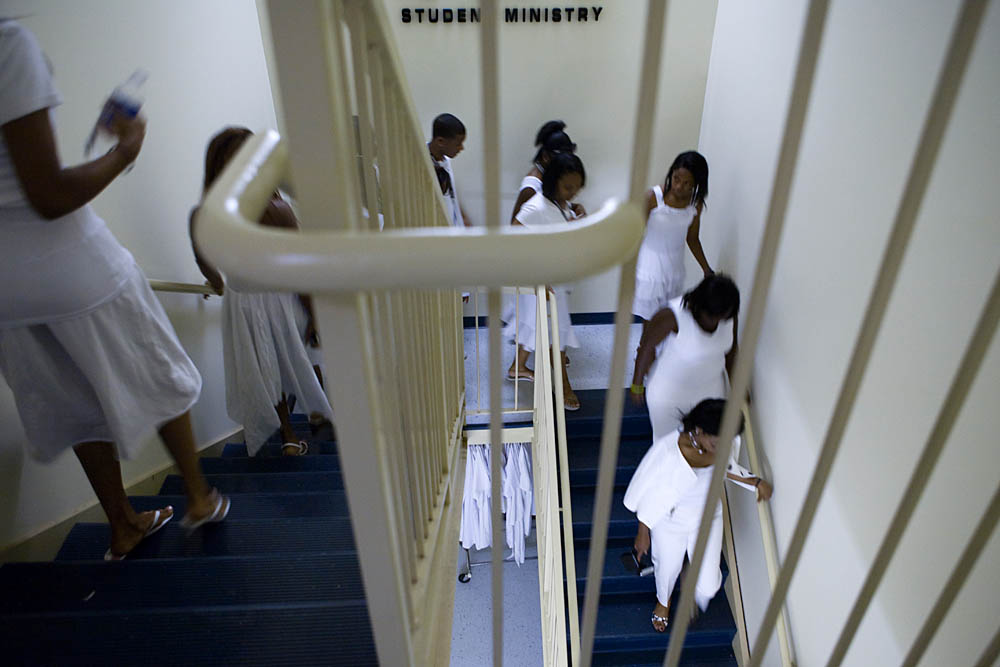 Teens head to the front of the church for the Purity Ring Ceremony at the Destiny World Church June 16 in Austell, GA. Young children, teenagers and their parents or guardians came together for three days to promote abstinence. Issues like STDs, peer pressure, teen pregnancy,  molestation and abuse were also main topics of panel discussions. The Holywood Retreat concluded with a Purity Ring Ceremony where each participant pledged to keep their virginity or to no longer participate in sex outside of marriage by wearing a {quote}purity ring{quote} on their wedding finger until the day it is replaced by a wedding ring. The three day event featured ministers and lay speakers, a fashion show that illustrated how one can remain modest and fashionable, a religious concert as well as other activities that entertained a predominantly young and energetic group.