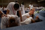 "Torrie Wilson, 13, cries at the altar during the Purity Ring Ceremony at the Destiny World Church June 16 in Austell, GA. Young children, teenagers and their parents or guardians came together for three days to promote abstinence. Issues like STDs, peer pressure, teen pregnancy,  molestation and abuse were also main topics of panel discussions. The Holywood Retreat concluded with a Purity Ring Ceremony where each participant pledged to keep their virginity or to no longer participate in sex outside of marriage by wearing a ""purity ring"" on their wedding finger until the day it is replaced by a wedding ring. The three day event featured ministers and lay speakers, a fashion show that illustrated how one can remain modest and fashionable, a religious concert as well as other activities that entertained a predominantly young and energetic group."