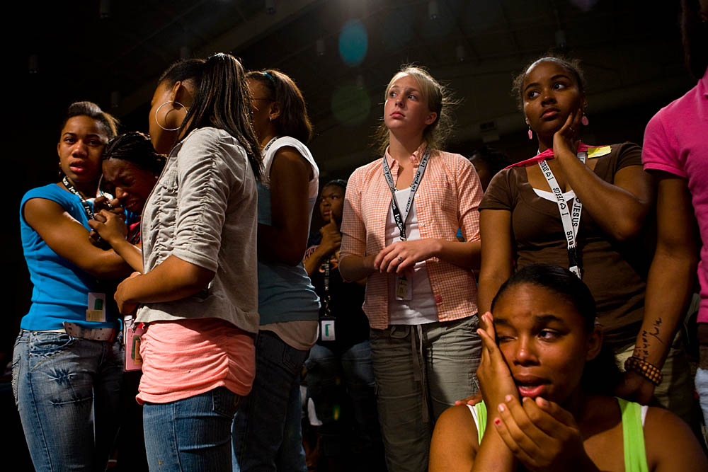 Tanyetta Hampton, 17, is comforted by friends during a Christian concert at the Destiny World Church June 14 in Austell, GA. Young children, teenagers and their parents or guardians came together for three days to promote abstinence. Issues like STDs, peer pressure, teen pregnancy,  molestation and abuse were also main topics of panel discussions. The Holywood Retreat concluded with a Purity Ring Ceremony where each participant pledged to keep their virginity or to no longer participate in sex outside of marriage by wearing a {quote}purity ring{quote} on their wedding finger until the day it is replaced by a wedding ring. The three day event featured ministers and lay speakers, a fashion show that illustrated how one can remain modest and fashionable, a religious concert as well as other activities that entertained a predominantly young and energetic group.