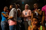 "Tanyetta Hampton, 17, is comforted by friends during a Christian concert at the Destiny World Church June 14 in Austell, GA. Young children, teenagers and their parents or guardians came together for three days to promote abstinence. Issues like STDs, peer pressure, teen pregnancy,  molestation and abuse were also main topics of panel discussions. The Holywood Retreat concluded with a Purity Ring Ceremony where each participant pledged to keep their virginity or to no longer participate in sex outside of marriage by wearing a ""purity ring"" on their wedding finger until the day it is replaced by a wedding ring. The three day event featured ministers and lay speakers, a fashion show that illustrated how one can remain modest and fashionable, a religious concert as well as other activities that entertained a predominantly young and energetic group."