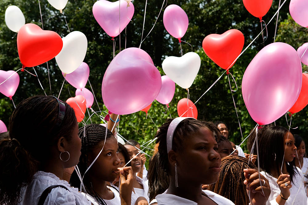 Virgins and {quote}second chance virgins{quote} release balloons into the air in celebration of their promise to stay chaste before marriage at the Destiny World Church June 16 in Austell, GA. Young children, teenagers and their parents or guardians came together for three days to promote abstinence. Issues like STDs, peer pressure, teen pregnancy,  molestation and abuse were also main topics of panel discussions. The Holywood Retreat concluded with a Purity Ring Ceremony where each participant pledged to keep their virginity or to no longer participate in sex outside of marriage by wearing a {quote}purity ring{quote} on their wedding finger until the day it is replaced by a wedding ring. The three day event featured ministers and lay speakers, a fashion show that illustrated how one can remain modest and fashionable, a religious concert as well as other activities that entertained a predominantly young and energetic group.