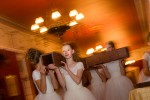 "The Regal Daughters Ballet Company carry a wooden cross to the middle of the ballroom at the Broadmoor Hotel on May 16, 2008 in Colorado Springs, CO. The annual Father-Daughter Purity Ball, founded in 1998 by Randy and Lisa Wilson, focuses on the idea that a trustworthy and nurturing father will influence his daughter to lead a lifestyle of ""integrity and purity."""
