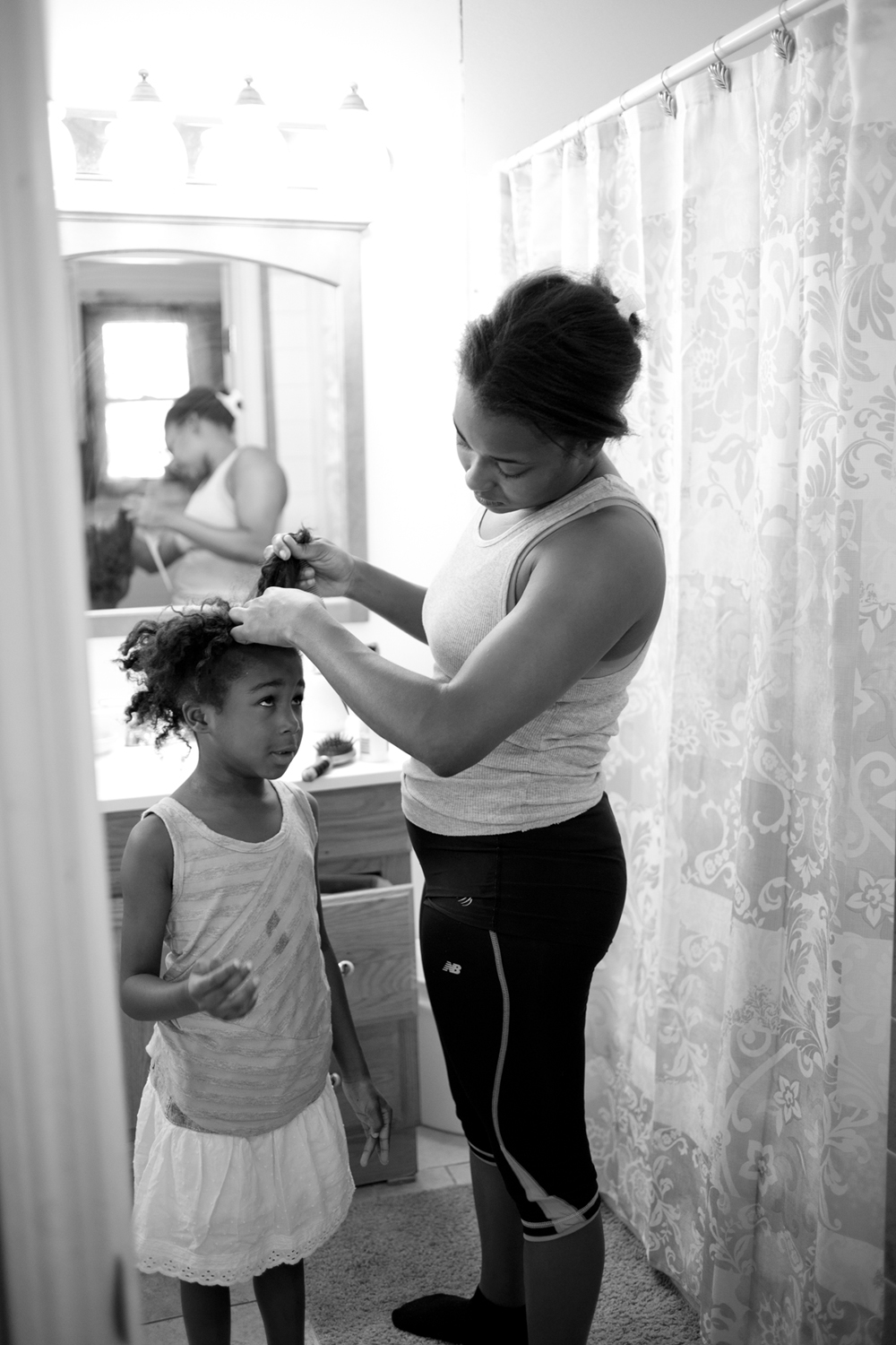 Former foster child, Dee St. Franc, 23, works two jobs to support herself and daughter, Azariah. During the day Dee helps other foster youth prepare for their future in Providence, RI. At night she works with elderly patients as a nurse's aide.