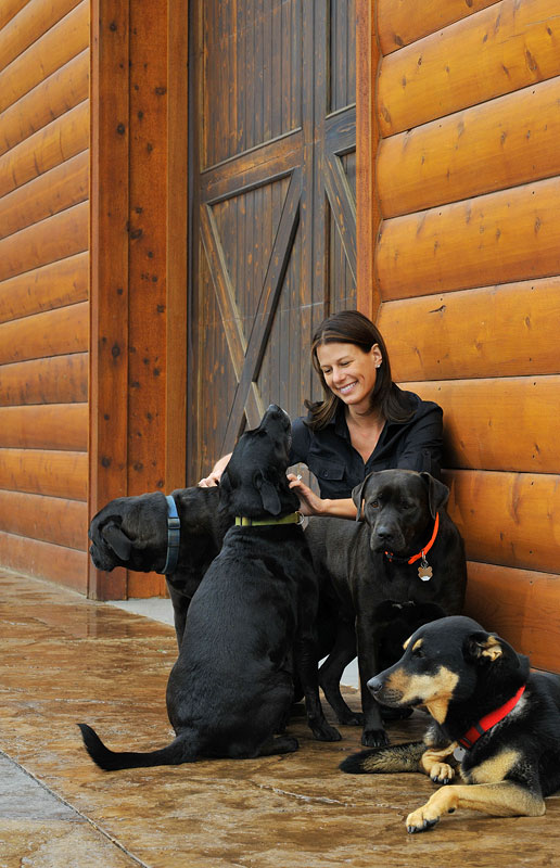 Krissie Newman with her rescued dogs. Photographed for the University City Magazine. Photos by Wendy Yang © The Charlotte Observer, used with permission