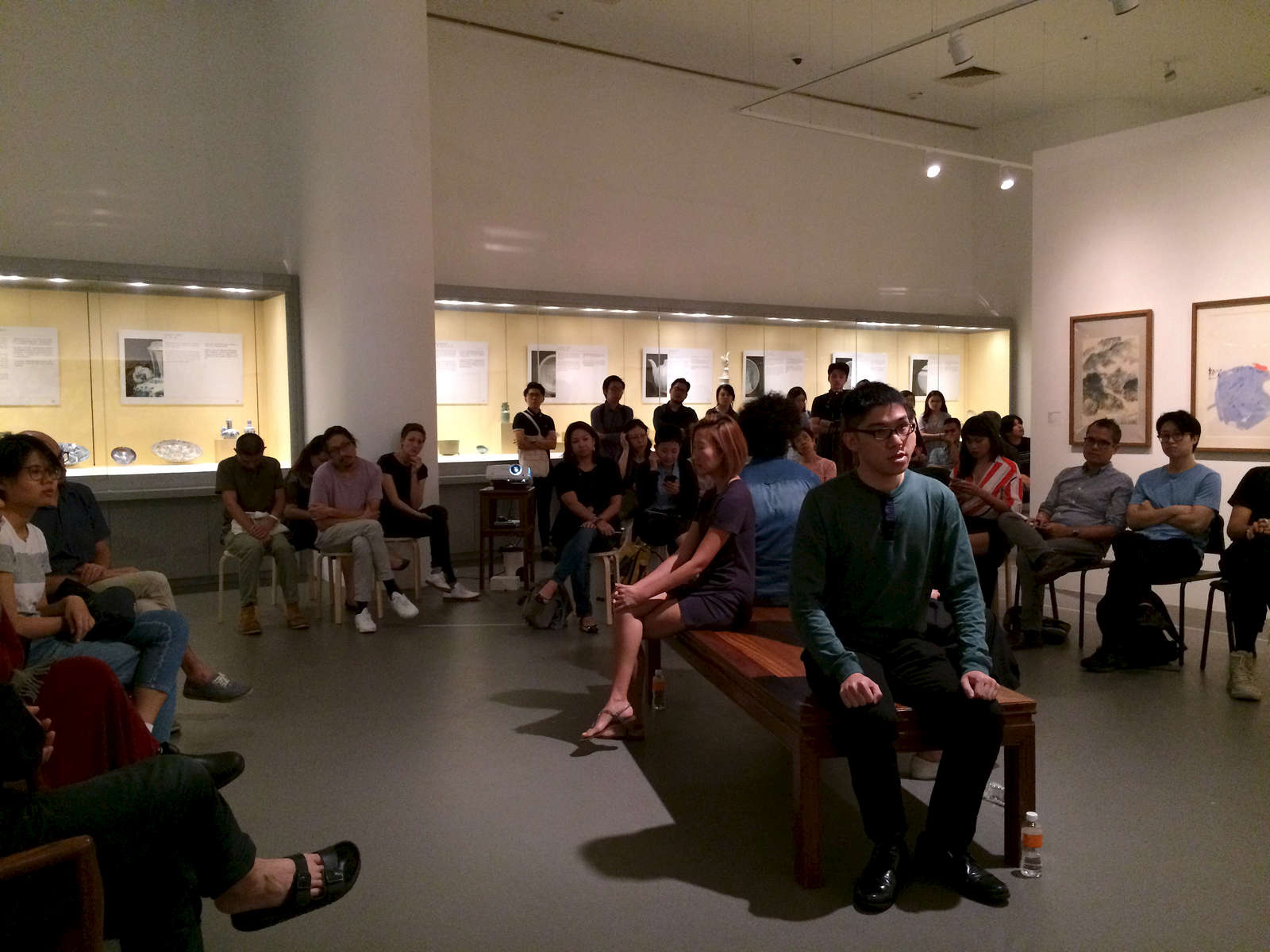 A recitation performance, centre right, during the opening of the 2nd iteration of Crossings at NUS Museum on May 3, 2018.
