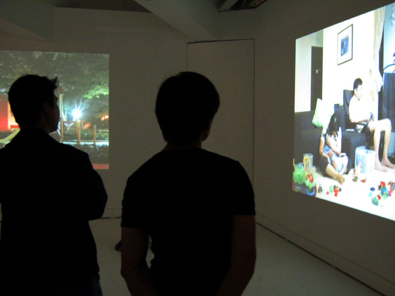 Installation view of two-channel projection with sound in 3-person exhibition Traces at Earl Lu Gallery, Instititute of Contemporary Arts, Singapore. August, 2009.