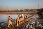 Children from the small villages of the area arrive at Infaq Campus, in Rehri Goth, Karachi, Sindh.