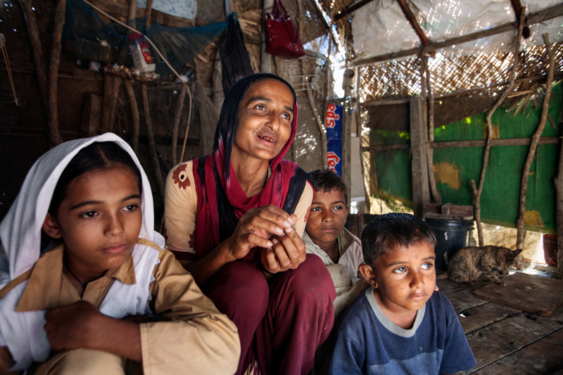 Kasbano says that she may be 35, but she isn't sure. She is Infaq Campus cleaner. Her daughter Seema is the only one of her family who attends the school. The boys are helping their father, who is a fisherman.