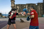 Mixed Martial Art fighter Angela Magana is training near San Cristobal Castle in Old San Juan.